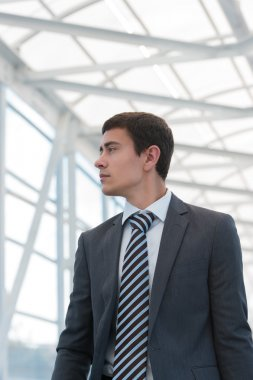 Businessman walking in urban environment