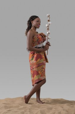 African woman holding cotton branch