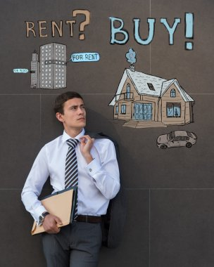 Businessman and Mortgage concept sign