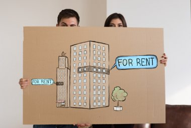 Couple with renting and credit concept sign