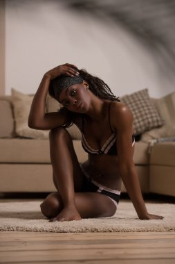alluring african woman in sexy lingerie