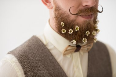 Man with beard in flowers