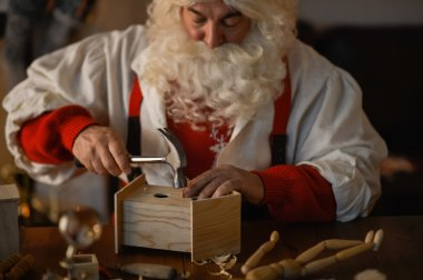 Santa making wooden nesting box