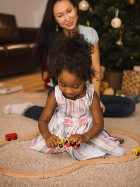 mother and daughter playing at Christmas time
