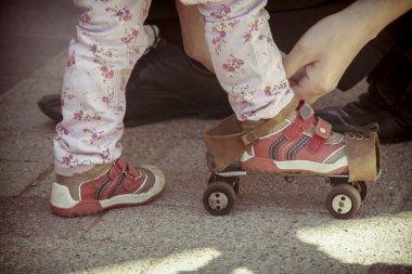 Old roller skates for infant girl