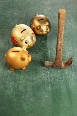 piggy banks and hammer