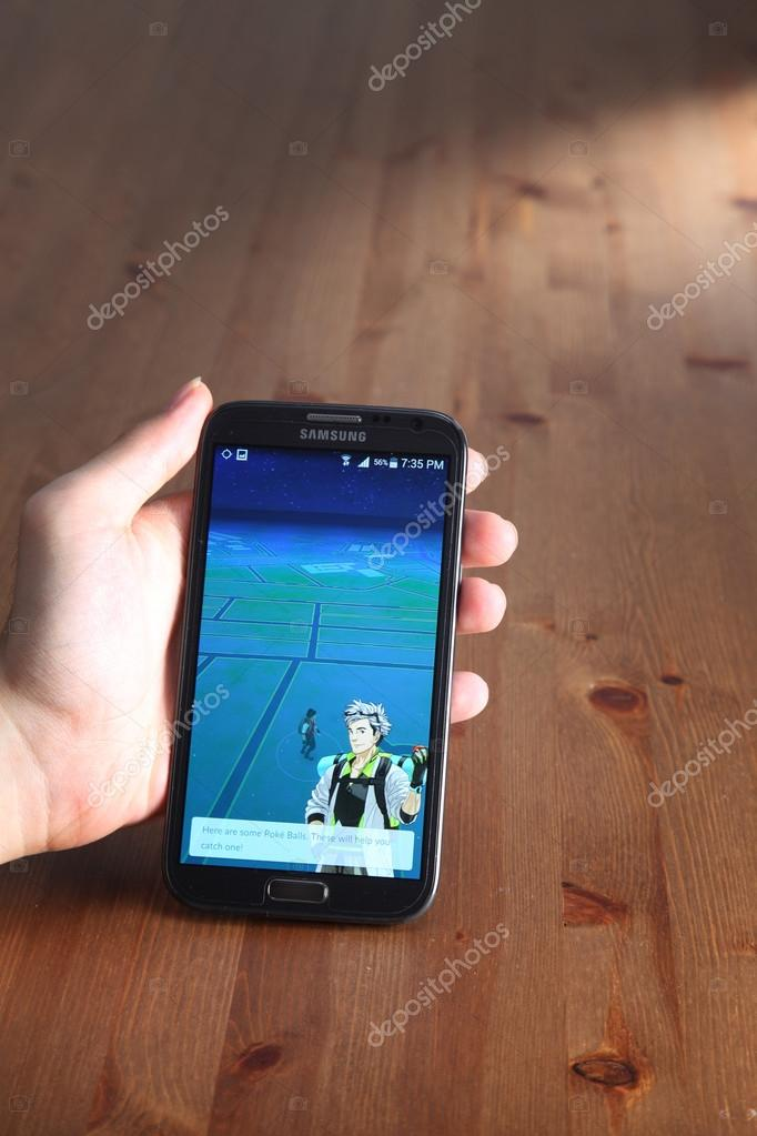 Player with Pokemon go on smartphone