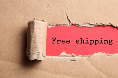 torn paper with free shipping inscription