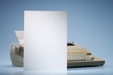 Sheet of paper in front of type writer