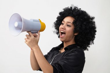 Indian girl in wig and with megaphone