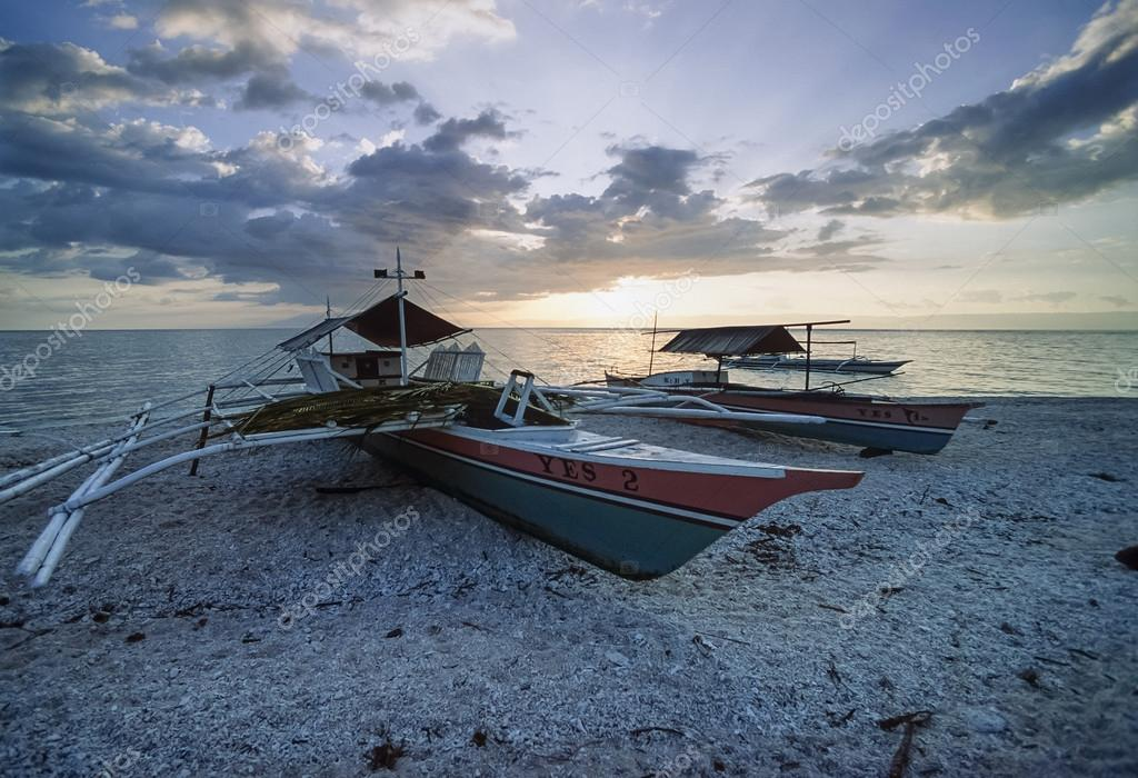 PHILIPPINES, Balicasag Island (Bohol); 24 March 2000, bancas (local wooden fishing boats) ashore at sunset - EDITORIAL (FILM SCAN)