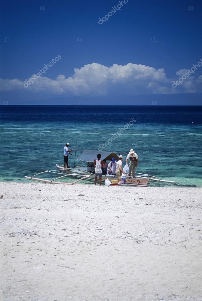 PHILIPPINES, Balicasag Island (Bohol); 24 March 2000, people on a local wooden fishing boat ashore - EDITORIAL (FILM SCAN)
