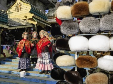 Russian women and fur hats in a market