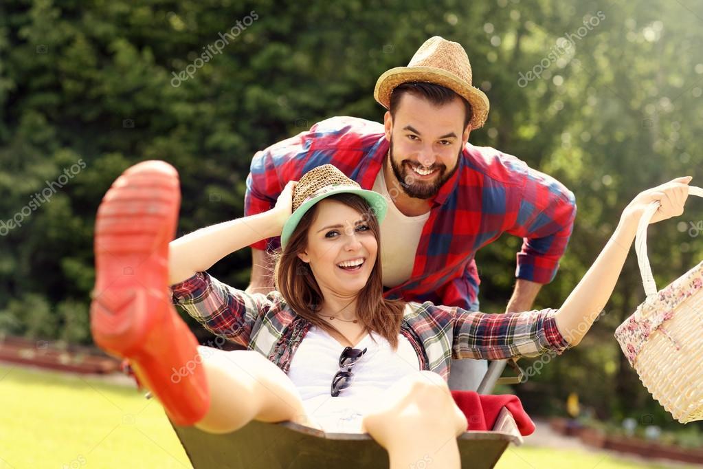 Couple having fun in the barrow