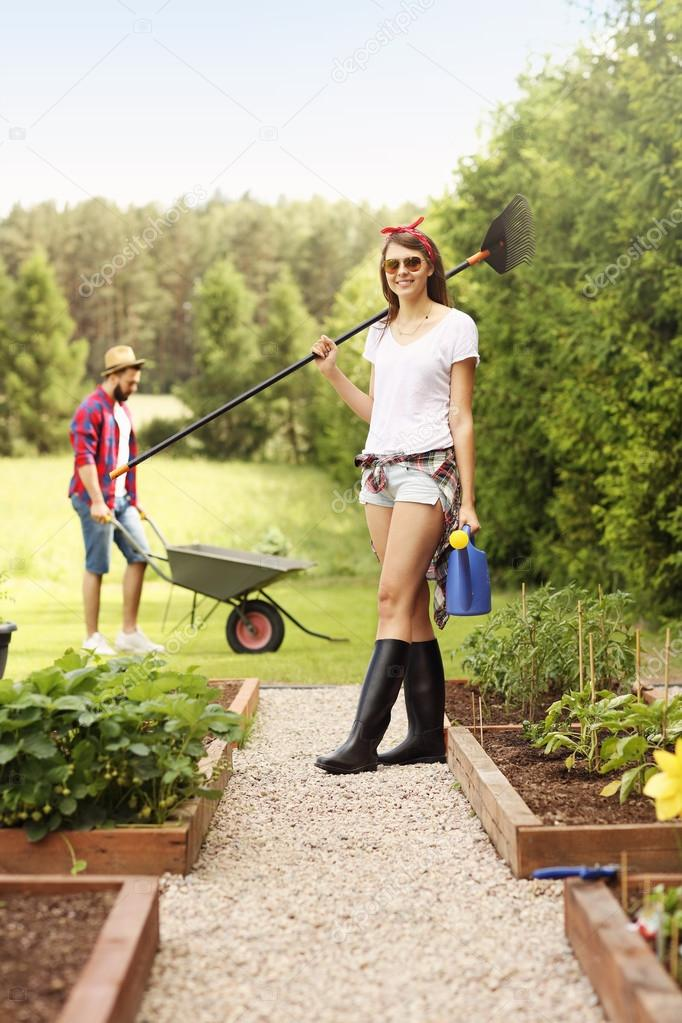 Couple working in the garden