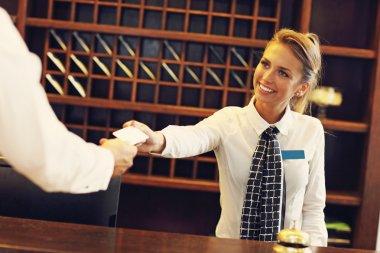 receptionist giving key card