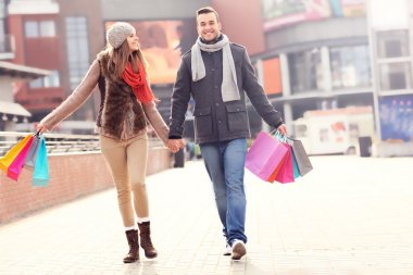 Cheerful couple shopping in the city