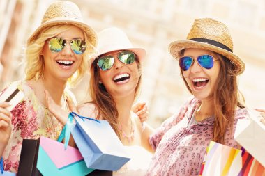 Group of happy friends shopping