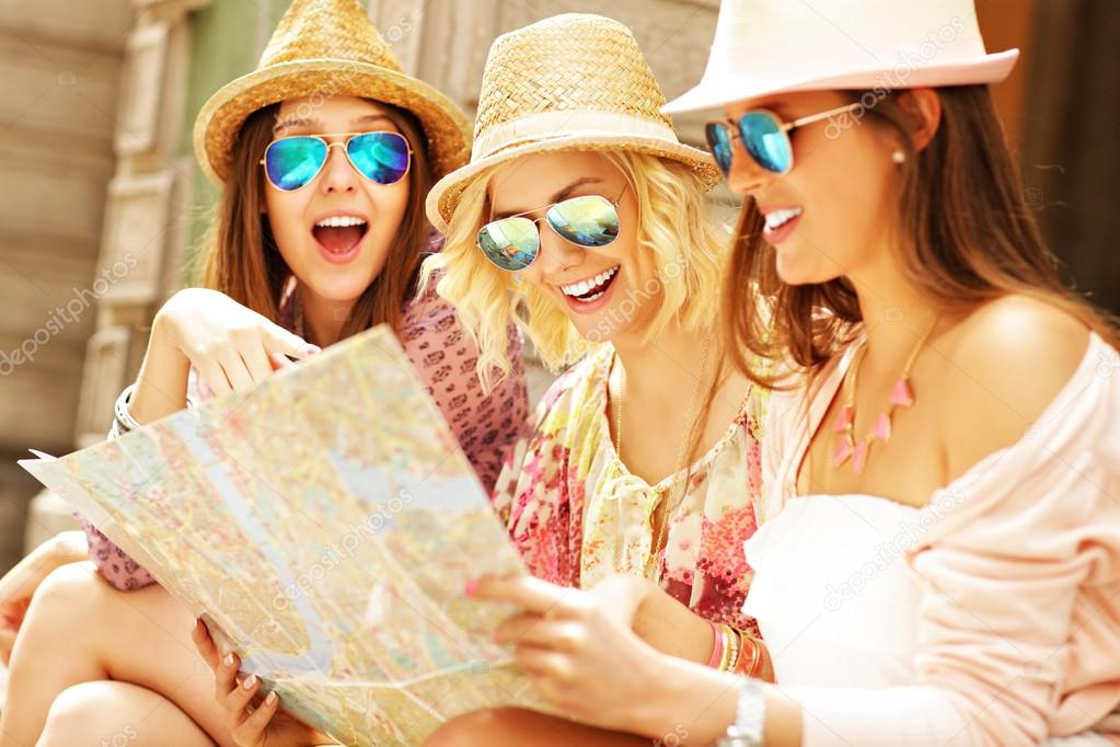Group of tourists using map