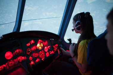 The girl pilot at the controls of the helicopter