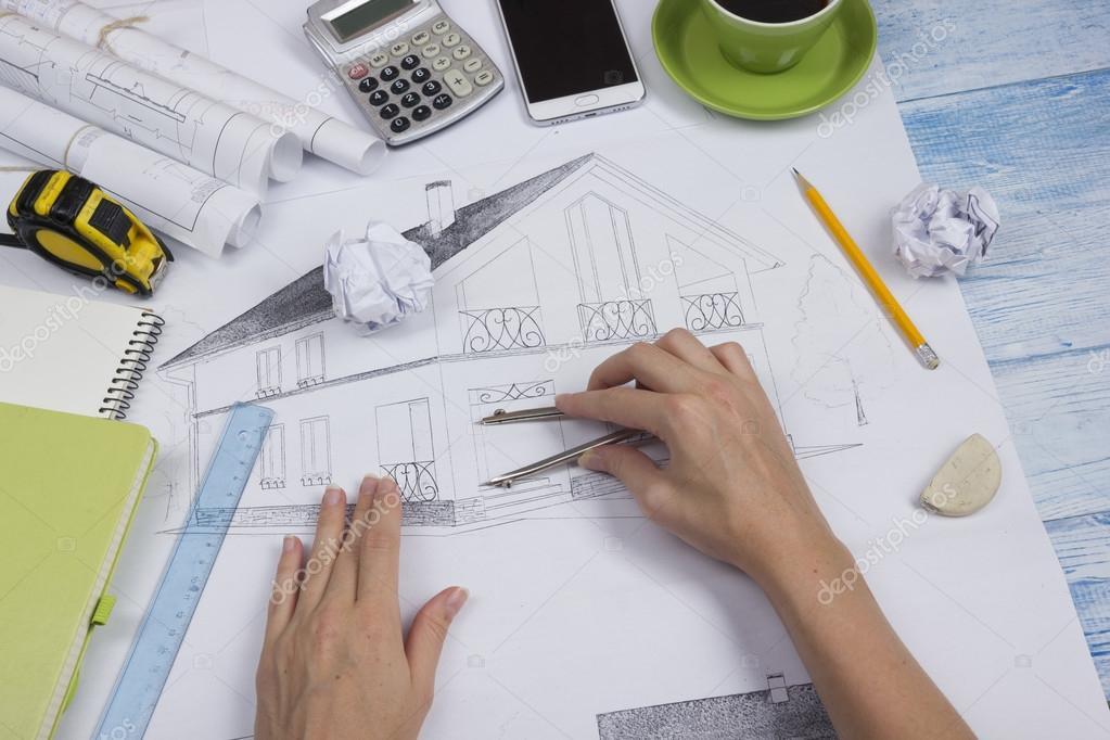 Trabajo sobre planos del arquitecto lugar de trabajo for Trabajo de arquitecto