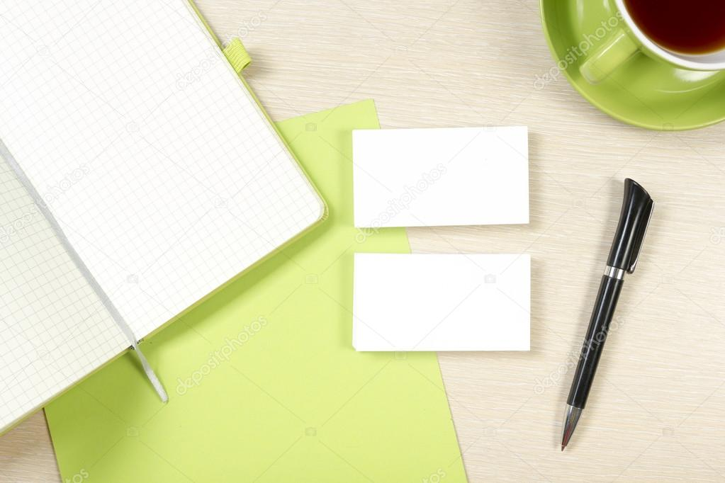 Business card blank, notepad, coffee cup and pen at office desk ...