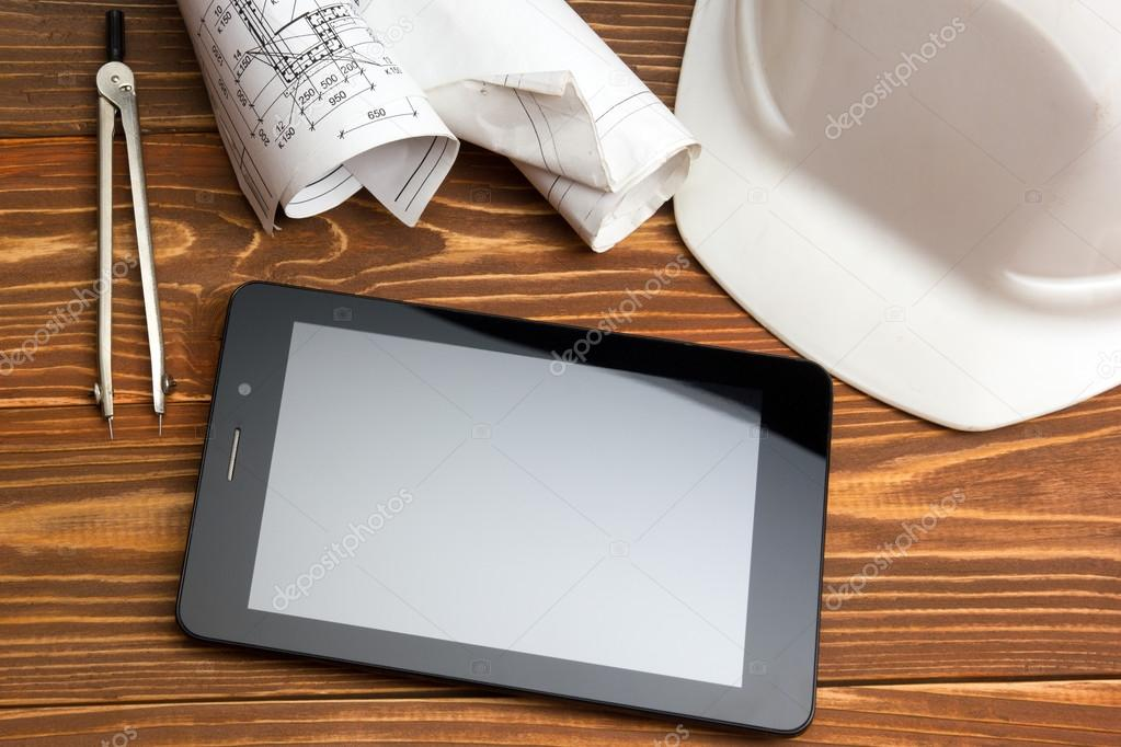 Workplace of architect architectural project plan blueprint workplace of architect architectural project plan blueprint rolls and tablet pc pen safety helmet on blank sheet paper malvernweather Image collections