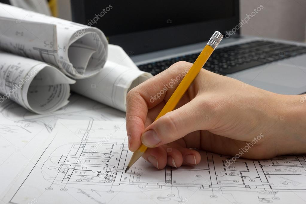 Architect working on blueprint architects workplace architectural architect working on blueprint architects workplace architectural project blueprints ruler calculator laptop and divider compass construction malvernweather Image collections