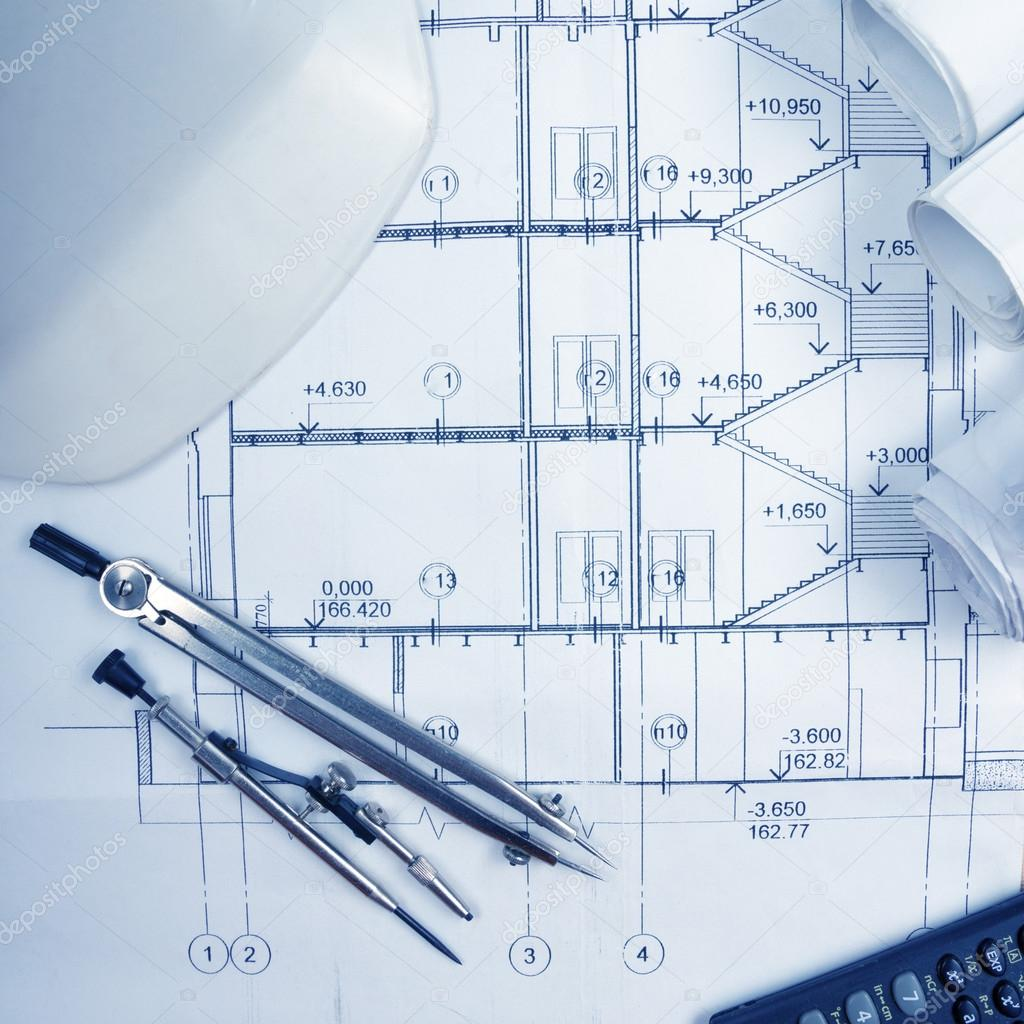 Architectural blueprints blueprint rolls compass divider calc architectural blueprints blueprint rolls compass divider calculator white safety on graph paper engineering tools view from the top copy space malvernweather Images