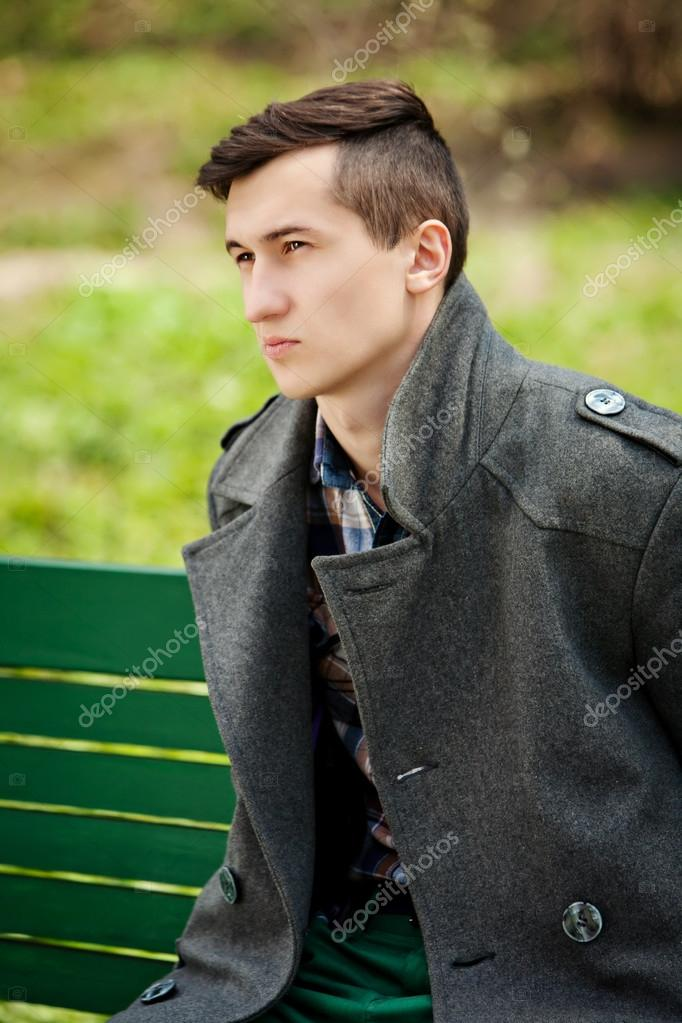 young man in a gray coat