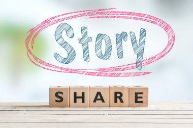 Share story sign on a table