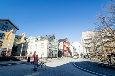 Early morning in Reykjavik with people in the streets