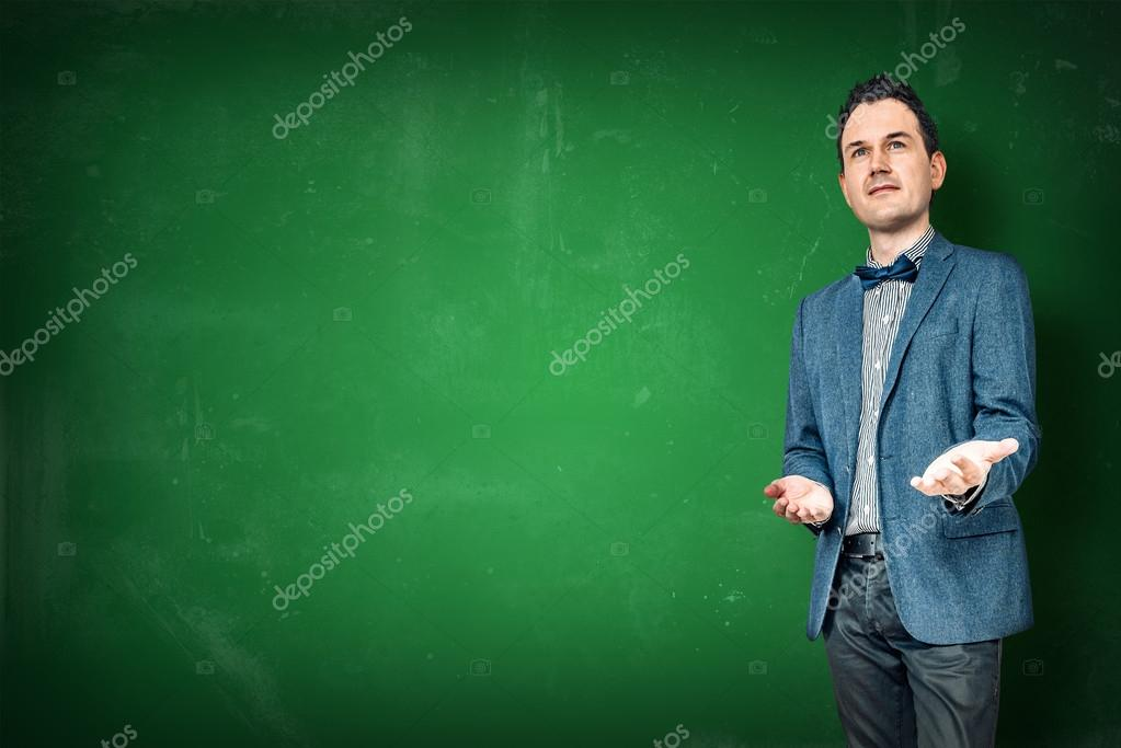 man teaching on a chalkboard stock photo sportactive 111134454