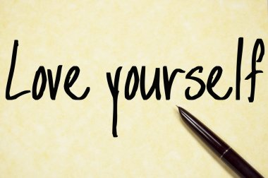 love youself text write on paper