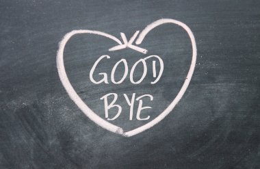 good bye text and heart sign on blackboard