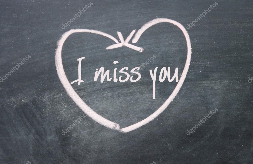 Tu me manques signe texte et coeur sur tableau noir photographie flytosky11 79675440 for Ecrire sur un tableau noir