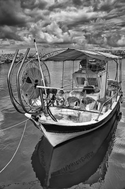 Fishing boat photographed in black and white in the harbor of La