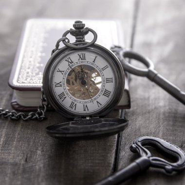 pocket watch on grunge wooden table