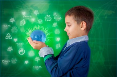 Recycling concept ,little boy holding a lighting ball in hand