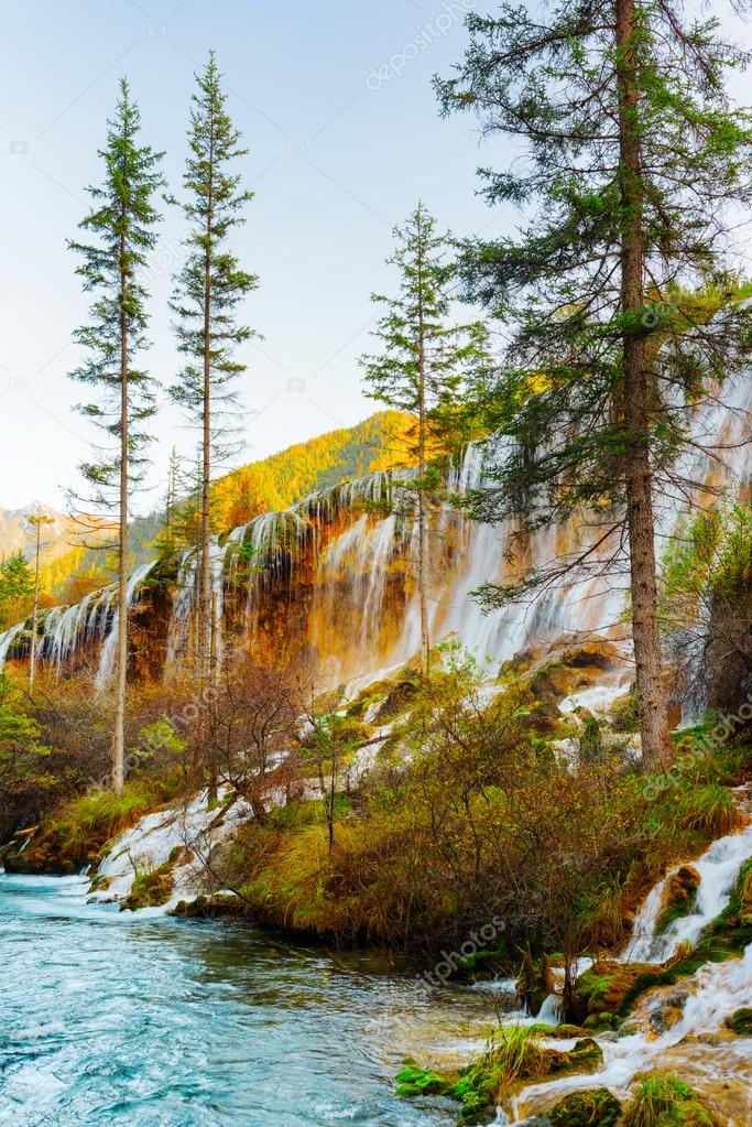 The Pearl Shoals Waterfall with crystal clear water among trees