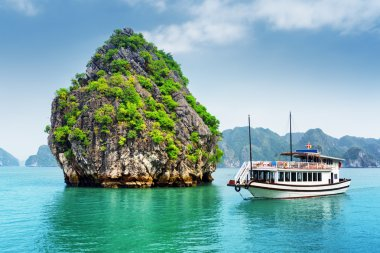 Beautiful view of karst isle and tourist boat in the Ha Long Bay