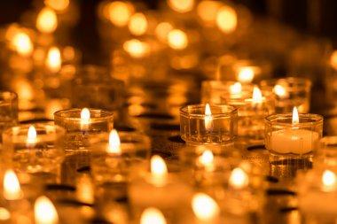 Burning orange candles close up stock vector