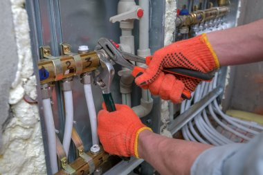 Pipefitter installing system of heating stock vector