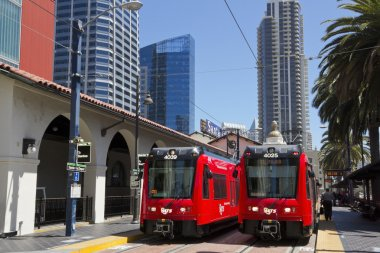 Two red trolley in San Diego.