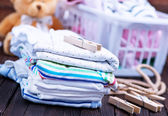 Photo Baby clothes and teddy bear
