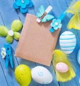 Fotografie Ostereier auf blauen Tisch