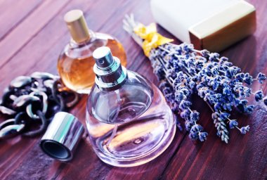 Perfumes in bottles on table