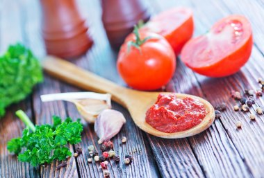 Tomato sauce in wooden spoon