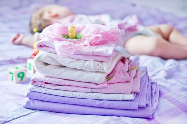 Baby clothes on the bed