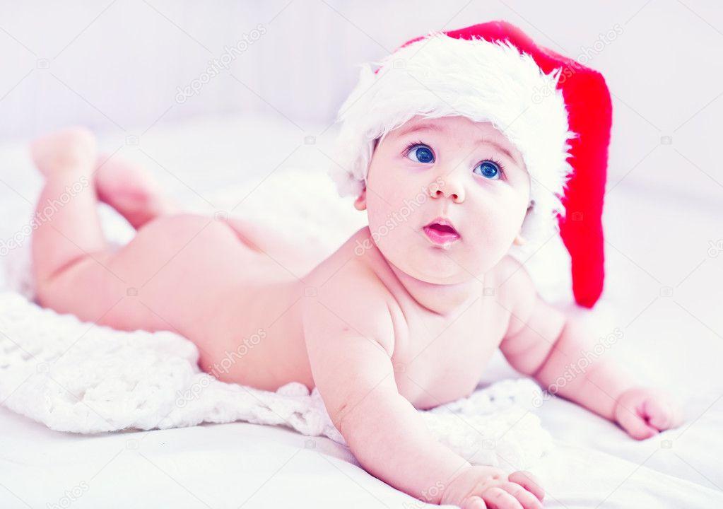 https://st2.depositphotos.com/1030624/8009/i/950/depositphotos_80097776-stock-photo-baby-in-christmas-hat.jpg